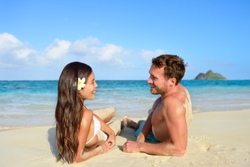 Couple in love relaxing on beach - vacation travel