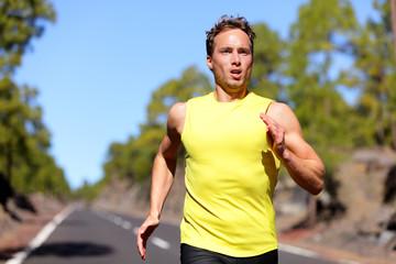 Running man sprinting for success on run