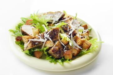 Caesar chicken salad on white background