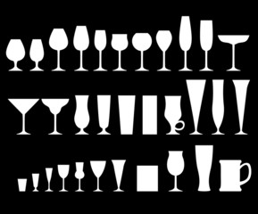 Set of glass goblets on black background