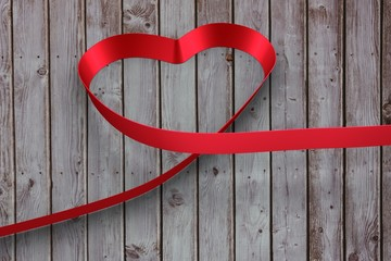 Wall Mural - Large red ribbon in a heart shape
