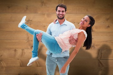 Composite image of attractive young couple having fun