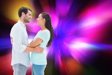 Composite image of attractive young couple hugging each other