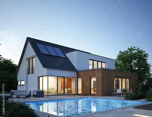 Haus anbau mit pool abend stockfotos und lizenzfreie for Haus anbau modern