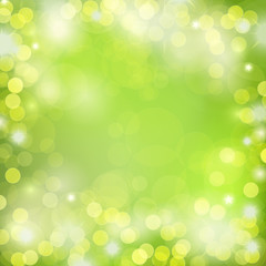 Bokeh lights on green background