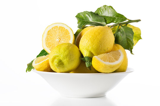 Lemons in a fruit bowl - isolated White background