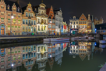 Quay Korenlei with reflections in Ghent town at night, Belgium