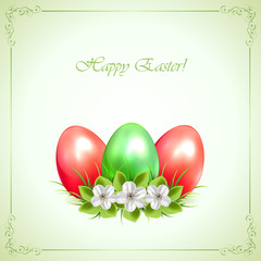 Three decorative Easter eggs on green background