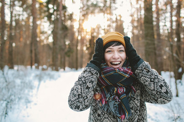 Young woman smiles in winter forest