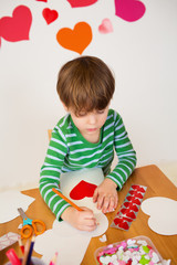 Child doing Valentine's Day Crafts, Love and Hearts