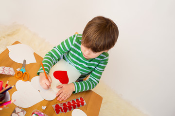 Child doing Valentine's Day Crafts: Hearts and Love