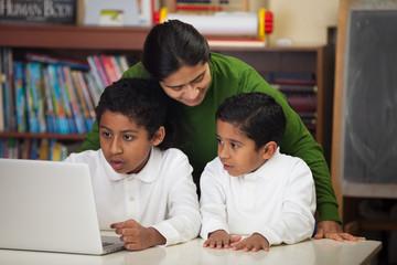 Hispanic Family with Laptop in Homeschool Setting
