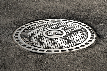 steel sewer cover on the street in Seoul, South Korea