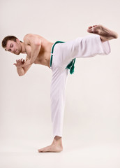 Capoeira dancer on white background