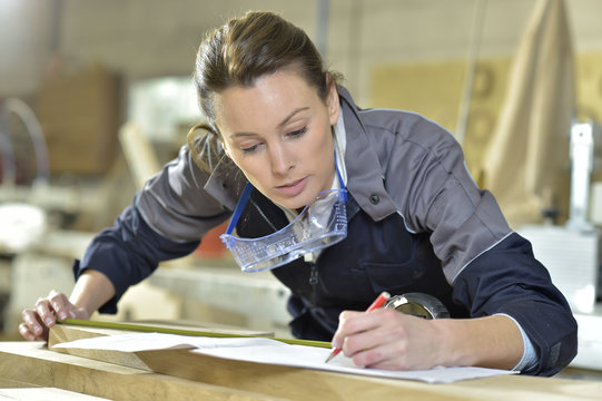 Young woman in carpentry professional training