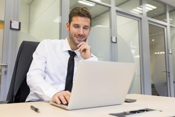 Businessman working on computer in modern office