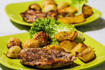 Chicken steak with roasted onions and potatoes