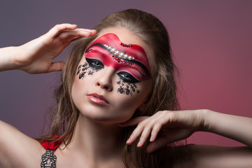 portrait of beautiful girl with creative make-up.