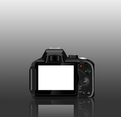 Digital SLR camera (dSLR) with a reflection on a table