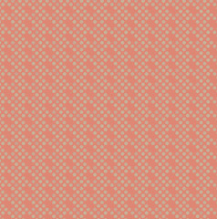 Pattern of small circles on terracotta background.
