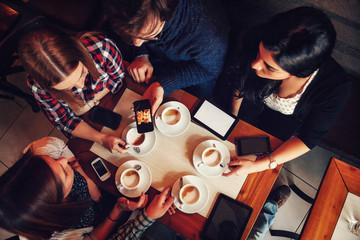 Friends In Cafe Drinking Coffee