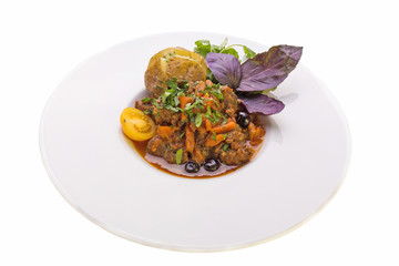WILD BOAR STEWED IN A POT WITH VEGETABLES AND BAKED POTATO
