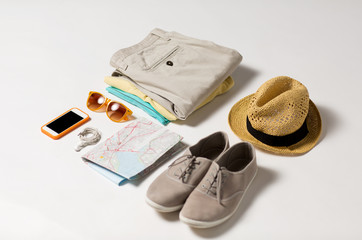 close up of summer clothes and travel map on table