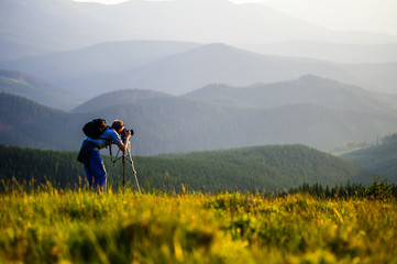 Professional photographer journey through the mountains.