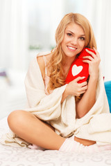 Young woman relaxing in bed with a hot water bottle
