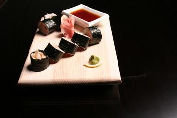 traditional sushi and sashimi on black background