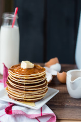 Pancake with butter, honey and milk, sweet breakfast