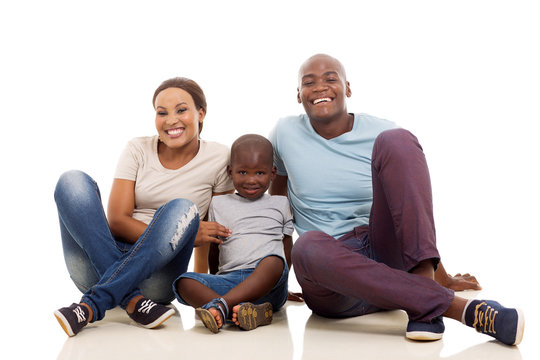 young african american family sitting on the floor