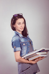 Young and beautiful student with books