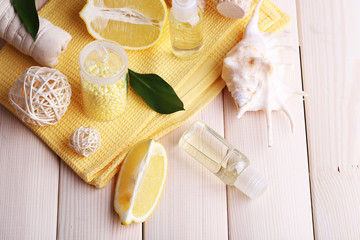 Spa still life with towel on wooden planks background
