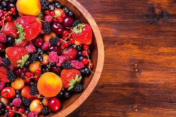 fresh berries on wooden bowl