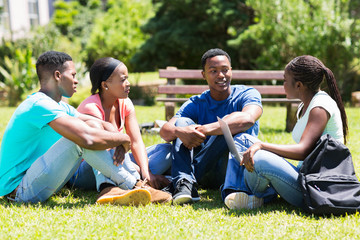 group of african university students relaxing outdoors