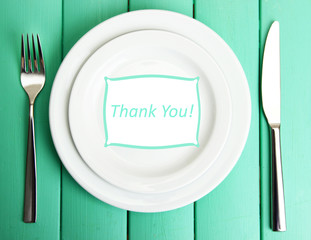 """Plate with text """"Thank you"""", fork and knife"""