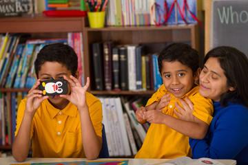 Hispanic Family in Home-School Environment
