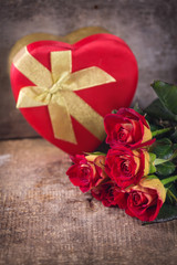 Fresh flowers and box with present