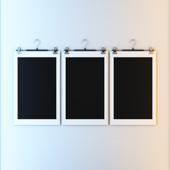 Papers with frame on hangers.