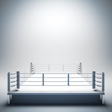 Empty white boxing ring.