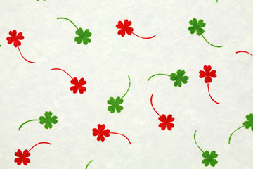 White mulberry paper with red and green leafs for background