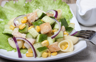 Salad with chicken meat, vegetables and pasta.