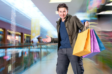 Smiling handsome man with shopping bags