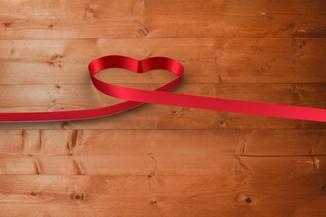Large red ribbon in a heart shape