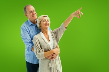 Composite image of happy mature couple embracing and looking