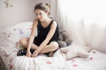 Girl sitting on bed