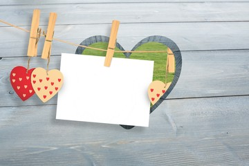 Wall Mural - Composite image of hearts hanging on the line