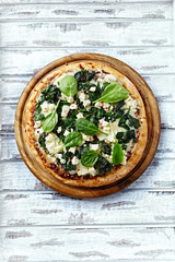 Spinach pizza with goat cheese