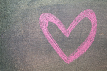 Hand drawn pink hearts on chalkboard background.